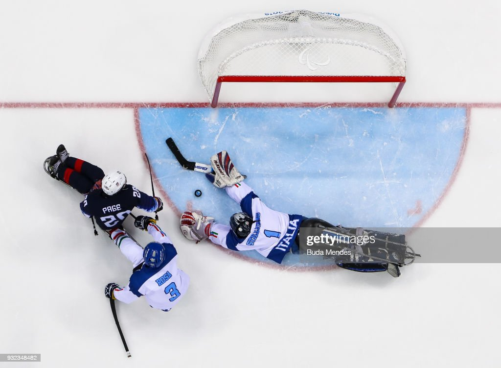 Adam Page #20 of the United States battles for the puck with a goalkeeper Santino Stillitano #1 of Italy in the Ice Hockey semifinals game between United States and Italy during day six of the PyeongChang 2018 Paralympic Games at Gangneung Hockey Centre on March 15, 2018 in Gangneung, South Korea.