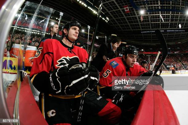 Adam Pardy and Mark Giordano of the Calgary Flames watch the game on the bench in between shifts against the Detroit Red Wings on November 22 2008 at...