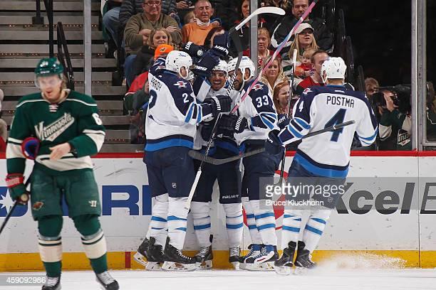 Adam Pardy Mathieu Perreault Evander Kane Dustin Byfuglien and Paul Postma of the Winnipeg Jets celebrate after scoring a goal against the Minnesota...