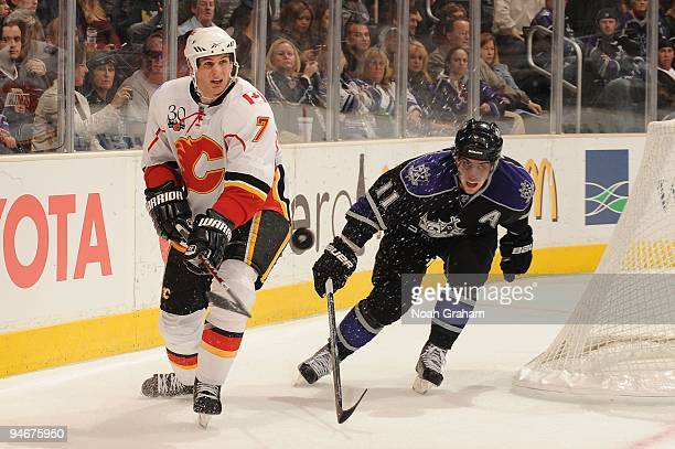 Adam Pardy of the Calgary Flames passes against Anze Kopitar of the Los Angeles Kings at Staples Center on November 21, 2009 in Los Angeles,...