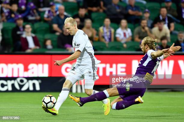 Adam Parkhouse of the Phoenix contests for the ball against Joseph Mills of the Glory during the round 11 ALeague match between the Perth Glory and...