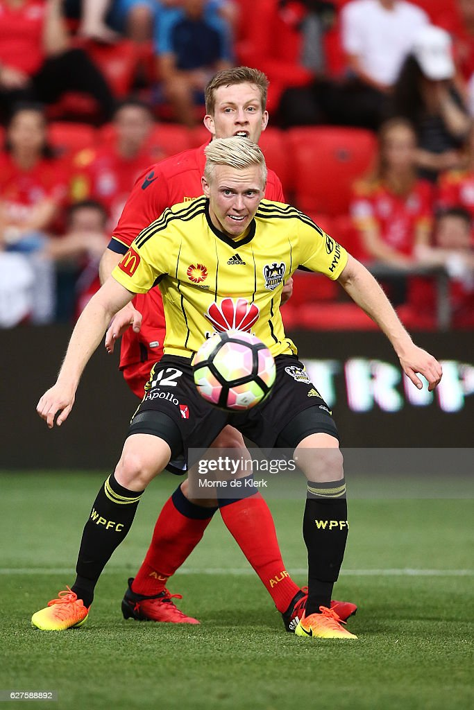 Adam Parkhouse of Wellington Phoenix and Ryan Kitto of Adelaide United compete for the ball during the round nine A-League match between Adelaide United and the Wellington Phoenix at Coopers Stadium on December 4, 2016 in Adelaide, Australia.