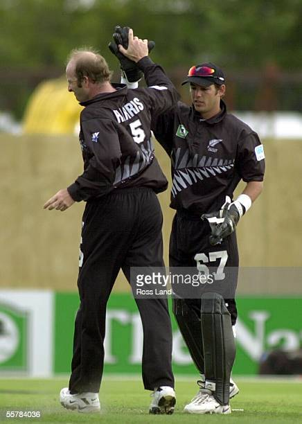 Adam Parore high fives with Chris Harris after Harris bowled Mahela Jayawadene for 46 during the Black Caps 13 run win over Sri Lanka in the final...