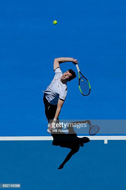 Adam Pavlasek of the Czech Republic serves to Jack Sock of the United States during their match on day one of the 2017 Hopman Cup at Perth Arena on...