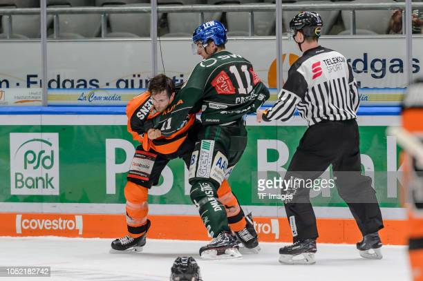 Adam Payerl of Augsburger Panther and Jeffrey Likens of Grizzlys Wolfsburg during fight the DEL match between Augsburger Panther and Grizzlys...