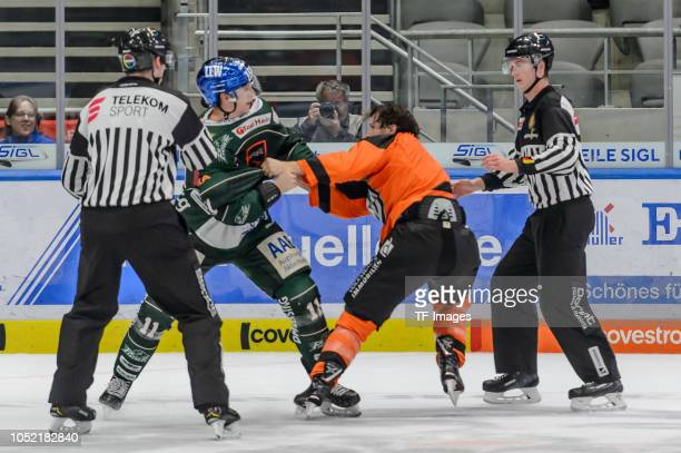 Adam Payerl of Augsburger Panther and Jeffrey Likens of Grizzlys Wolfsburg fight during the DEL match between Augsburger Panther and Grizzlys...