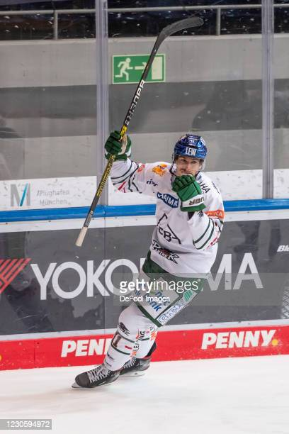 Adam Payerl of Augsburger Panther celebrates his 0:1 goal during the DEL match between EHC Red Bull Muenchen and Augsburger Panther on January 12,...