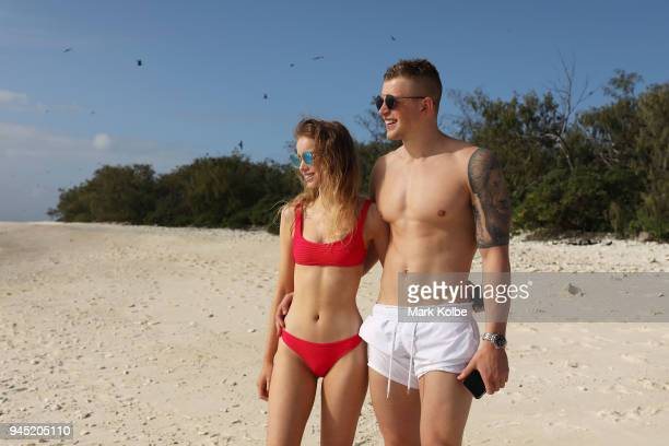 Adam Peaty and Millicent Jenner of England pose on the beach during an athlete Great Barrier Reef experience on day eight of the Gold Coast 2018...