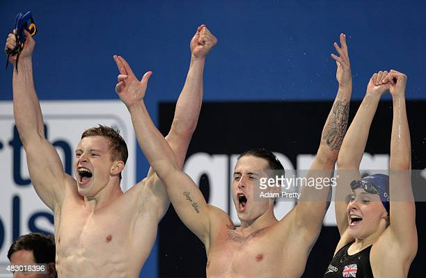 Adam Peaty Chris WalkerHebborn and SiobhanMarie O'Connor of Great Britain celebrate winning the gold medal in a new world record of 34171 in the...