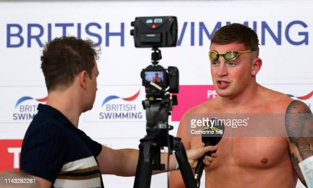 Adam Peaty is interviewed after his 50m Breaststoke heat during Day Two of the British Swimming Championships at Tollcross International Swimming...