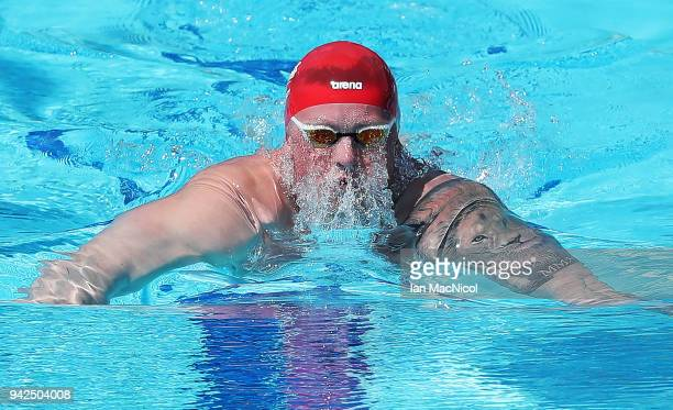 Adam Peaty of England competes during the Swimming heats of the Men's 100m Breaststroke on day two of the Gold Coast 2018 Commonwealth Games at Optus...