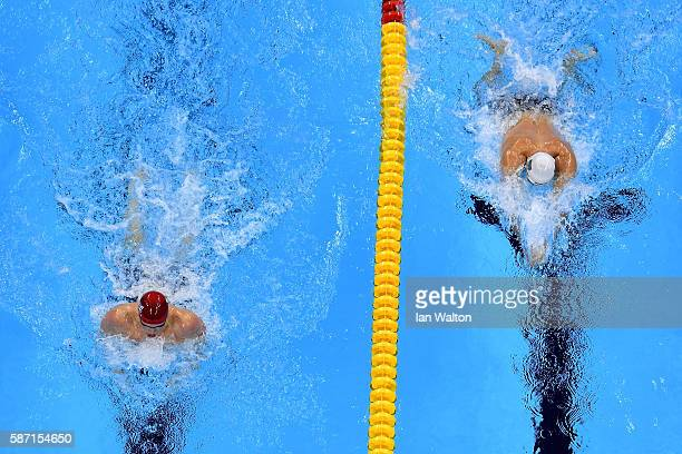Adam Peaty of Great Britain and Cameron van der Burgh of South Africa compete in the Men's 100m Breaststroke Final on Day 2 of the Rio 2016 Olympic...