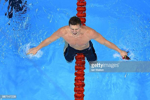 Adam Peaty of Great Britain celebrates winning gold and setting a new world record in the Men's 100m Breaststroke Final on Day 2 of the Rio 2016...