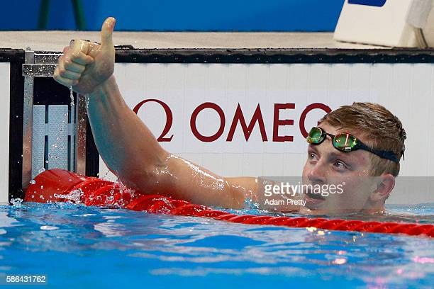 Adam Peaty of Great Britain celebrates winning heat six in a new world record time in the Men's 100m Breaststroke on Day 1 of the Rio 2016 Olympic...