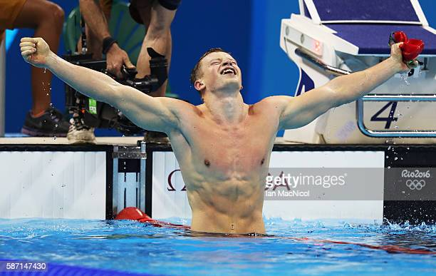 Adam Peaty of Great Britain celebrates winning the Men's 100m Breaststroke during Day 2 of the Rio 2016 Olympic Games at Olympic Aquatics Stadium on...
