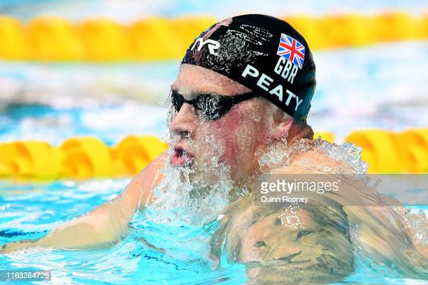 Adam Peaty of Great Britain competes in the Men's 100m Breaststroke heats on day one of the Gwangju 2019 FINA World Championships at Nambu...