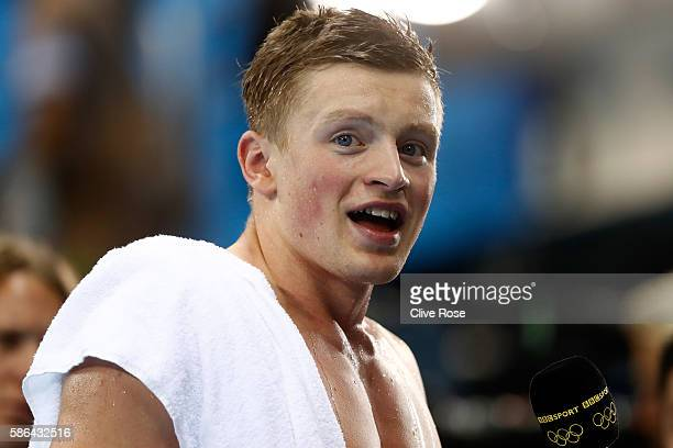 Adam Peaty of Great Britain is interviewed after winning heat six in a new world record time in the Men's 100m Breaststroke on Day 1 of the Rio 2016...
