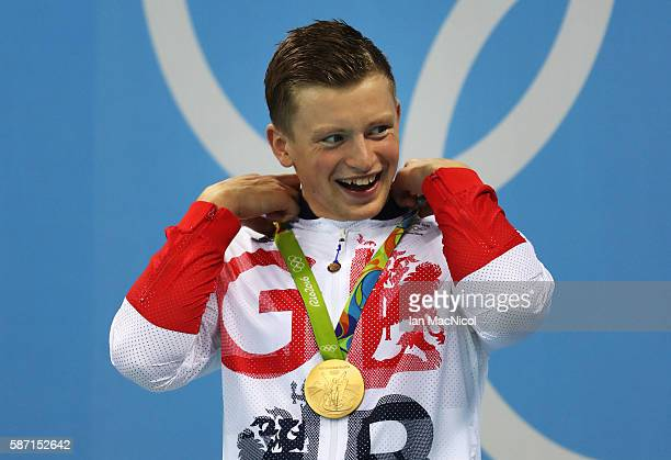 Adam Peaty of Great Britain poses with his Gold medal from the Men's 100m Breaststroke during Day 2 of the Rio 2016 Olympic Games at Olympic Aquatics...