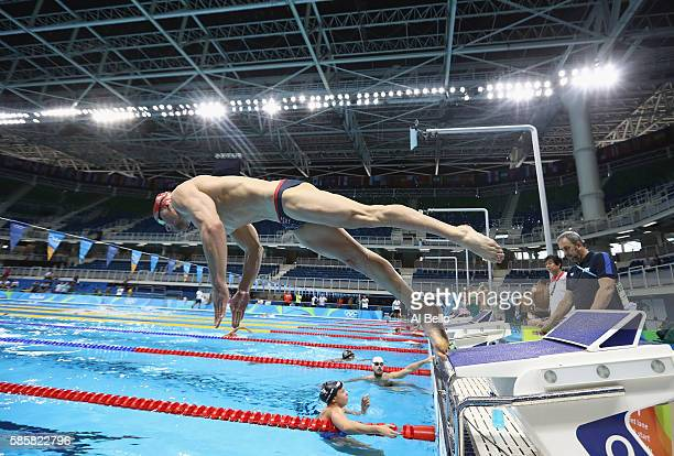 Adam Peaty of Great Britain practices starts during swim training one day before the start of the Rio Olympics on August 4 2016 in Rio de Janeiro...