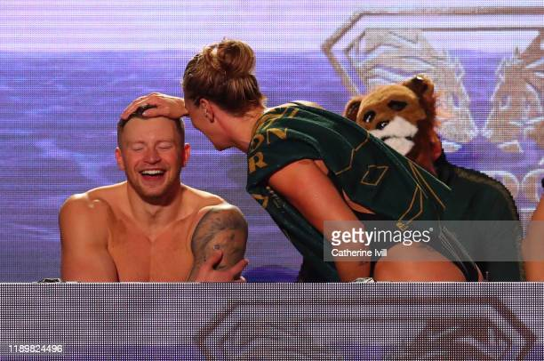 Adam Peaty of London Roar shares a joke with a team mate during Day Two of the International Swimming League at Aquatics Centre on November 24 2019...