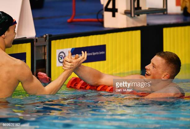 Adam Peaty of Loughboro Uni celebrates with Ross Murdoch of Uni of Stirling following his victory in the Mens Open 100m Breaststroke final on day one...