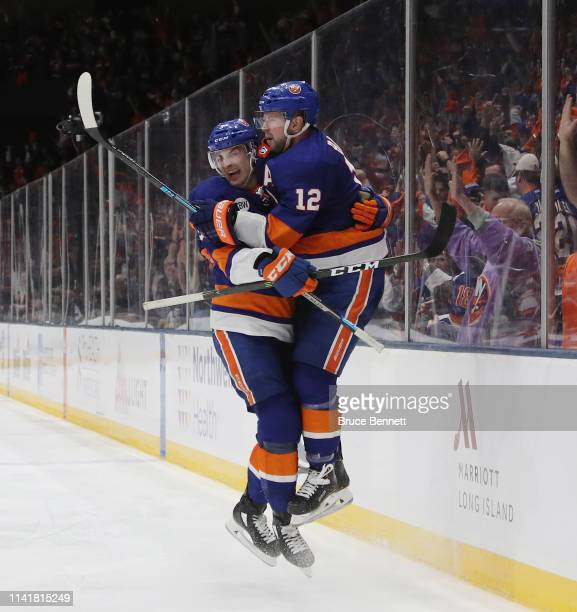 Adam Pelech and Josh Bailey of the New York Islanders celebrate Bailey's game winning overtime goal against the Pittsburgh Penguins in Game One of...