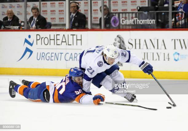 Adam Pelech of the New York Islanders attempts to stop Brayden Point of the Tampa Bay Lightning during the first period at the Barclays Center on...