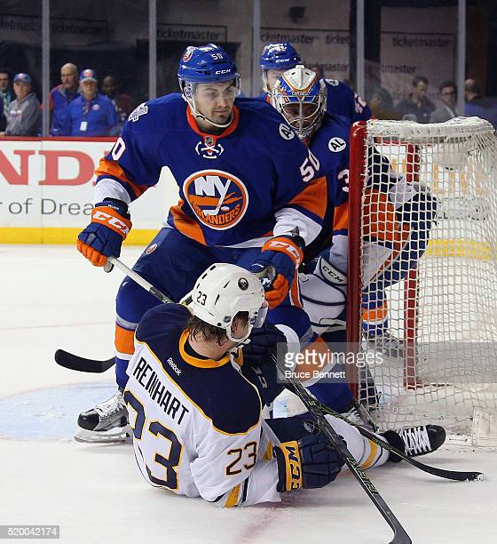 Adam Pelech of the New York Islanders dumps Sam Reinhart of the Buffalo Sabres during the first period at the Barclays Center on April 9 2016 in the...