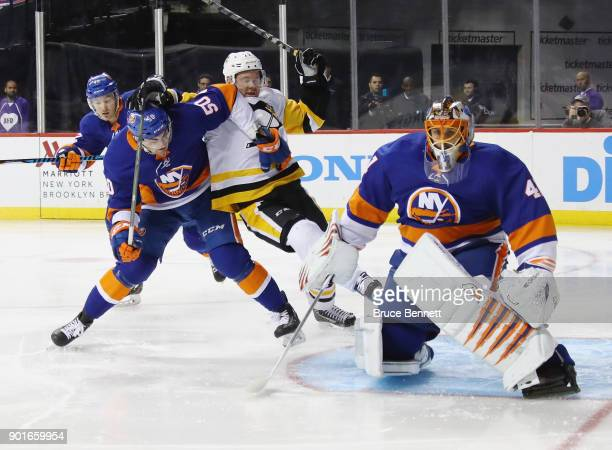 Adam Pelech of the New York Islanders holds Patric Hornqvist of the Pittsburgh Penguins during the first period at the Barclays Center on January 5...