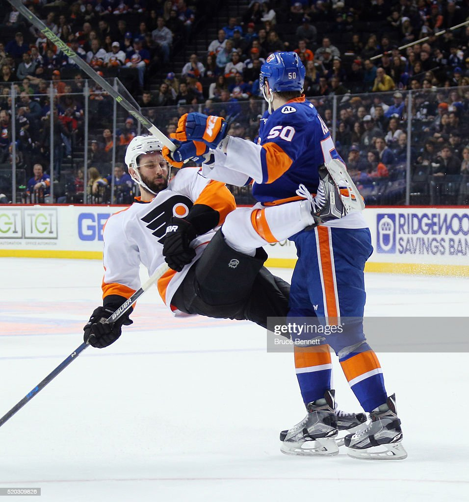 Adam Pelech #50 of the New York Islanders steps into Sam Gagner #89 of the Philadelphia Flyers during the first period at the Barclays Center on April 10, 2016 in the Brooklyn borough of New York City.