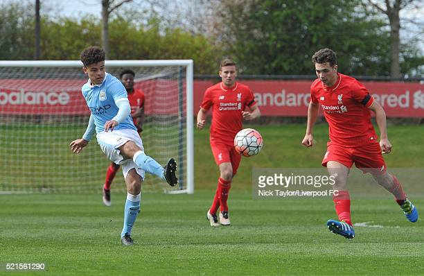 Adam Phillips and Herbie Kane of Liverpool and Joel Latibeaudiere of Manchester City in action during the Liverpool v Manchester City U18 Premier...