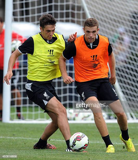 Adam Phillips and Jordan Henderson of Liverpool in action during a training session at Harvard Univarsity on July 24 2014 in Cambridge Massachusetts