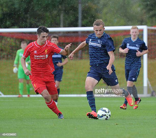 Adam Phillips of Liverpool and Charles Vernam of Derby County in action during the Barclays Premier League Under 18 fixture between Liverpool and...