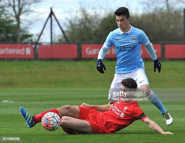 Adam Phillips of Liverpool and Manuel Garcia of Manchester City in action during the Liverpool v Manchester City U18 Premier League game at the...