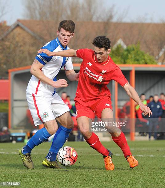 Adam Phillips of Liverpool and Matthew Platt of Blackburn Rovers in action during the Liverpool v Blackburn Rovers U18 Premier League game at the...