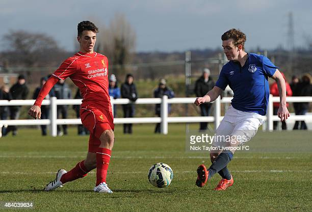 Adam Phillips of Liverpool and Michael Donohue of Everton in action during the U18 Premier League match between Everton and Liverpool at Finch Farm...
