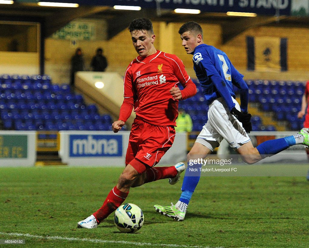 Adam Phillips of Liverpool and Perry Cotton of Birmingham City in action during the FA Youth Cup 5th Round match between Liverpool and Birmingham City at The Swansway Chester Stadium on January 30, 2015 in Chester, England.