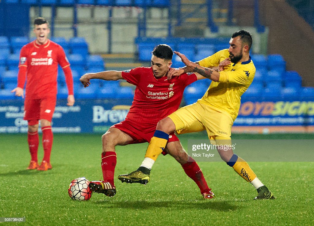 Adam Phillips of Liverpool and Tommaso Bianchi of Leeds United in action during the Liverpool v Leeds United U21 Premier League Cup game at Prenton Park on January 19, 2016 in Birkenhead, England.