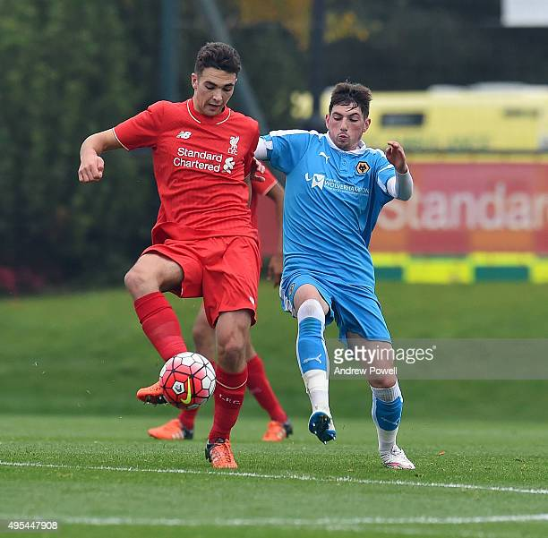 Adam Phillips of Liverpool competes with Bradley Lindsey of Wolverhampton Wanderers during the Barclays U18 Premier League match between Liverpool...
