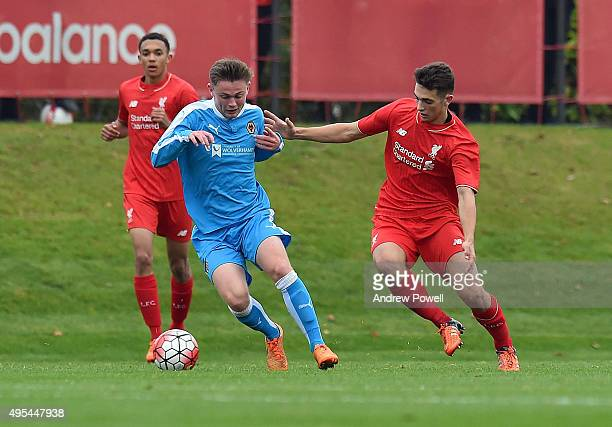 Adam Phillips of Liverpool competes with Conor Levingston of Wolverhampton Wanderers during the Barclays U18 Premier League match between Liverpool...