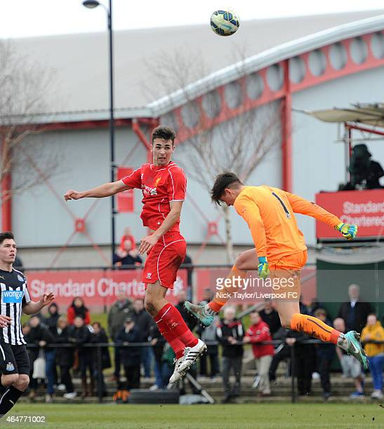 Adam Phillips of Liverpool loops a headder goal wards over the oncoming Newcastle United gaolkeeper Brendan Pearson during the U18 Premier League...