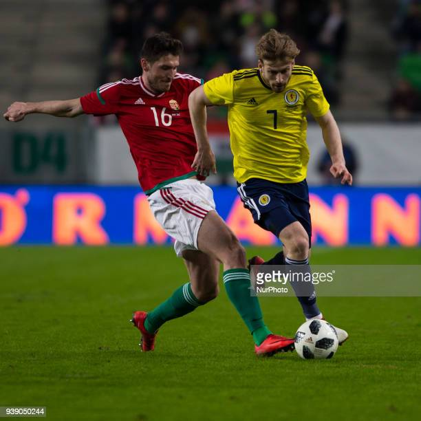 Adam Pintér of Hungary competes for the ball with Stuart Armstrong of Scotland during the friendly match between Hungary and Scotland at Groupama...