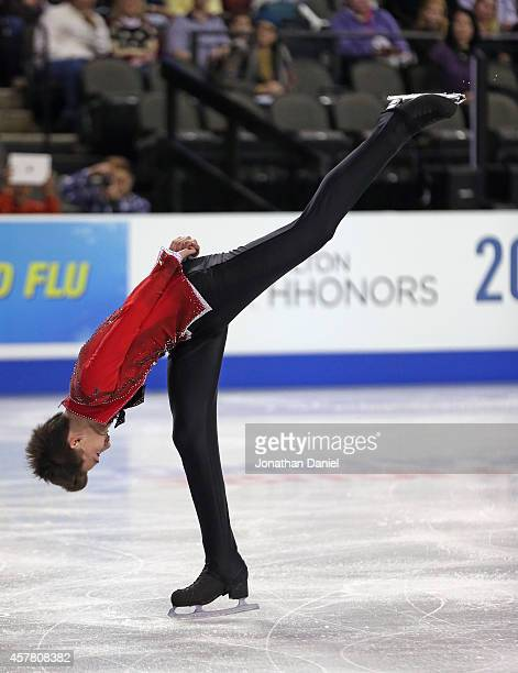 Adam Pitkeev competes in the Men Short Program during the 2014 Hilton HHonors Skate America competition at the Sears Centre Arena on October 24 2014...