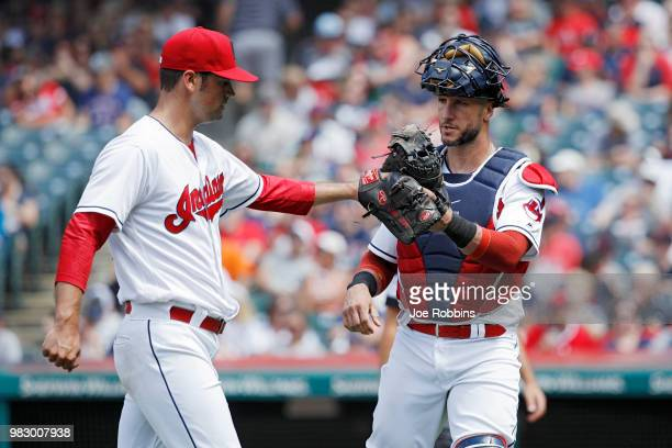 Adam Plutko and Yan Gomes of the Cleveland Indians celebrate after pitching out the sixth inning against the Detroit Tigers at Progressive Field on...