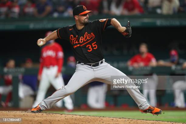Adam Plutko of the Baltimore Orioles pitches against the Texas Rangers in the eighth inning at Globe Life Field on April 16, 2021 in Arlington, Texas.