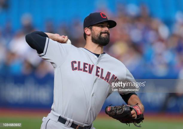 Adam Plutko of the Cleveland Indians delivers a pitch in the first inning during MLB game action against the Toronto Blue Jays at Rogers Centre on...