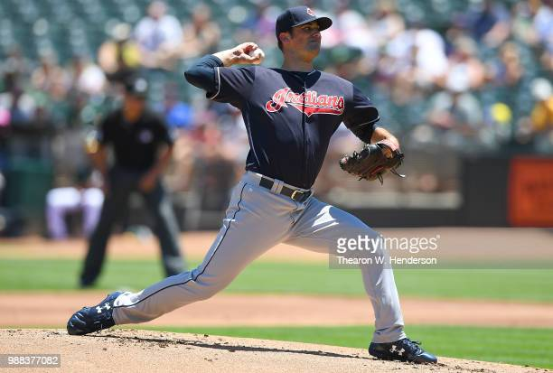 Adam Plutko of the Cleveland Indians pitches against the Oakland Athletics in the bottom of the first inning at Oakland Alameda Coliseum on June 30...
