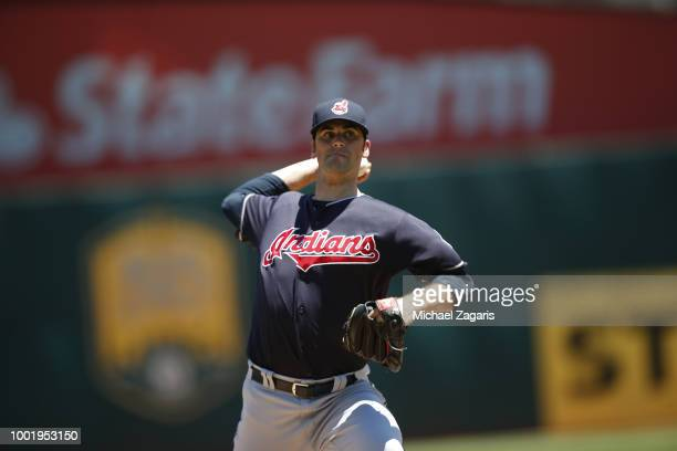 Adam Plutko of the Cleveland Indians pitches during the game against the Oakland Athletics at the Oakland Alameda Coliseum on June 30 2018 in Oakland...