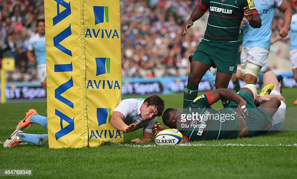 Adam Powell of the Falcons fails to stop Tigers winger Vereniki Goneva from scoring his second try during the Aviva Premiership match between...