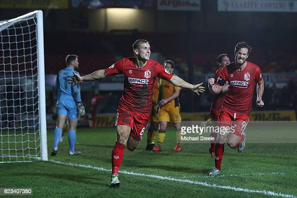 Adam Priestley of Alfreton celebrates scoring the equaliser during the Emirates FA Cup first round replay match between Newport County and Alfreton...